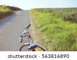an old bike on journeys. going... | Shutterstock . vector #563816890