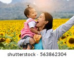 mother and children are happy... | Shutterstock . vector #563862304
