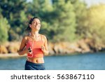 Small photo of young healthy lifestyle woman running on beach