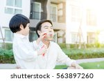 cute little boy and father is... | Shutterstock . vector #563897260