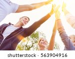 team of teenagers high five in... | Shutterstock . vector #563904916