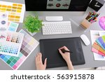 young designer drawing sketches ... | Shutterstock . vector #563915878