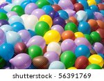 Many air balloons under net - stock photo