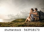 hikers with backpacks relaxing... | Shutterstock . vector #563918173