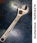 Small photo of Adjustable Spanner on the oily work bench at workshop