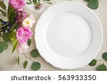 flower arrangement on table... | Shutterstock . vector #563933350