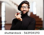 Small photo of young french artist with pipe