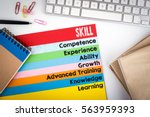 skill concept. office desk with ... | Shutterstock . vector #563959393