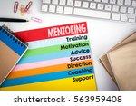 mentoring concept. office desk... | Shutterstock . vector #563959408