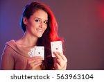beautiful brunette holding four ... | Shutterstock . vector #563963104