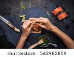 slices of raw salmon on ice.... | Shutterstock . vector #563982859