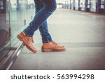 male legs in jeans and leather... | Shutterstock . vector #563994298