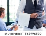 close up of waiter standing... | Shutterstock . vector #563996530