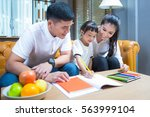 father and mather teach and... | Shutterstock . vector #563999104