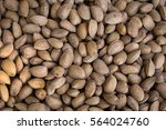 Small photo of Almond.Almonds an market. Background of almonds. Healthy almonds. Fresh almonds.