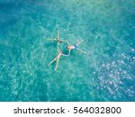 aerial view of three young... | Shutterstock . vector #564032800