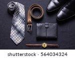 men's accessories on black...