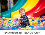 cheerful little boy sitting and ... | Shutterstock . vector #564037294