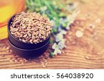 flax seeds in bowl on blue... | Shutterstock . vector #564038920