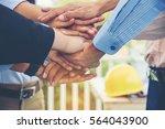 close up hands of team work... | Shutterstock . vector #564043900