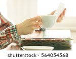 woman looking her photo album.... | Shutterstock . vector #564054568