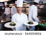 happy chef presenting her food... | Shutterstock . vector #564054856