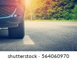 car on asphalt road on summer... | Shutterstock . vector #564060970