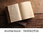 Old Books On Wooden Background...