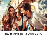 group of happy young friends... | Shutterstock . vector #564068890