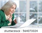 smiling senior woman    Shutterstock . vector #564073324