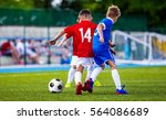 boys kicking soccer ball on... | Shutterstock . vector #564086689