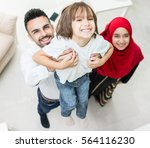 happy muslim family at modern... | Shutterstock . vector #564116230
