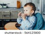 portrait of a boy drinking a... | Shutterstock . vector #564125800