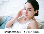 young woman in bedroom with... | Shutterstock . vector #564144808