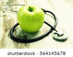 health. green apple with