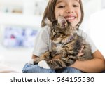 Stock photo happy kid at home playing with kitty cat 564155530