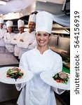 team of chefs in the kitchen... | Shutterstock . vector #564156919