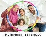happy arabic muslim family at... | Shutterstock . vector #564158200