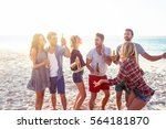 happy friends dancing together... | Shutterstock . vector #564181870