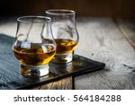 whiskey with ice in glasses ...   Shutterstock . vector #564184288
