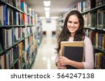 in the library   pretty female... | Shutterstock . vector #564247138