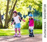 girl and boy learn to roller... | Shutterstock . vector #564248728