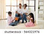 indian family playing with ball ... | Shutterstock . vector #564321976