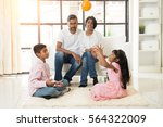 indian family playing with ball ... | Shutterstock . vector #564322009