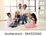 indian family playing with ball ... | Shutterstock . vector #564322060