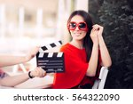 happy actress with oversized... | Shutterstock . vector #564322090