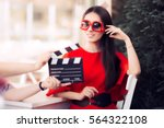 happy actress with oversized... | Shutterstock . vector #564322108