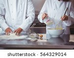 focused chef preparing a cake... | Shutterstock . vector #564329014