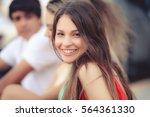 portrait of a happy latin girl... | Shutterstock . vector #564361330