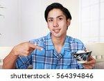 asian man having breakfast | Shutterstock . vector #564394846